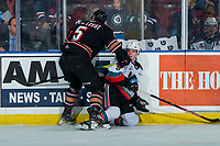KELOWNA, BC - FEBRUARY 17: Jackson van de Leest #5 of the Calgary Hitmen checks Mark Liwiski #9 of the Kelowna Rockets to the ice during first period at Prospera Place on February 17, 2020 in Kelowna, Canada. (Photo by Marissa Baecker/Shoot the Breeze)