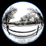 Wantagh, New York, USA. February 20, 2019. Scene of rail wood fence and beyond at Mill Pond Park on Long Island. 180 degree fisheye view, 3 digital versions.