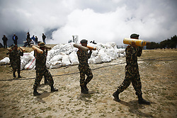 May 27, 2019 - Namche Bazar, Nepal - Nepalese Army carry oxygen cylinders collected from the high camps of Mount Everest during the Everest clean up campaign at Namche Bazar in Nepal on Monday, May 27, 2019. (Credit Image: © Skanda Gautam/ZUMA Wire)
