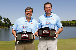 Matt Luke and Wesley Wells pose with Peach Bowl Challenge Trophy after winning the Chick-fil-A Peach Bowl Challenge at the Oconee Golf Course at Reynolds Plantation, Sunday, May 1, 2018, in Greensboro, Georgia. (Paul Abell via Abell Images for Chick-fil-A Peach Bowl Challenge)