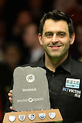 21.02.2016. Cardiff Arena, Cardiff, Wales. Bet Victor Welsh Open Snooker. Ronnie O'Sullivan versus Neil Robertson. Ronnie O'Sullivan beats Neil Robertson and is seen with the trophy.