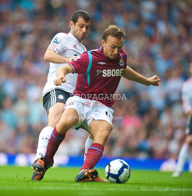 LONDON, ENGLAND - Saturday, September 19, 2009: Liverpool's Javier Mascherano and West Ham United's Mark Noble during the Premiership match at Upton Park. (Pic by David Rawcliffe/Propaganda)