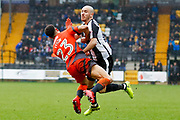 Wycombe Wanderers forward Nathan Tyson (23) is clatters by Notts County midfielder Liam Noble (18)  during the EFL Sky Bet League 2 match between Notts County and Wycombe Wanderers at Meadow Lane, Nottingham, England on 30 March 2018. Picture by Simon Davies.
