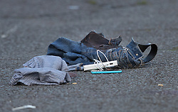 © Licensed to London News Pictures. 30/09/2017. London, UK. A blood soaked pair of trousers and other possessions lie in the street after a man was fatally stabbed in Bow, East London. Police were called at 2:30 am on Saturday, 30 September to reports of a disturbance in E3. Officers found a 21-year-old man suffering from stab injuries. He was treated at the scene by London's Air Ambulance before being taken to an east London hospital where he died. Detectives from the Homicide and Major Crime Command are investigating. Photo credit: Peter Macdiarmid/LNP
