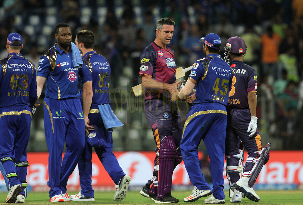 Rising Pune Supergiants player Kevin Pietersen shake hands with Mumbai Indians captain Rohit Sharma after the match 1 of the Vivo Indian Premier League ( IPL ) 2016 between the Mumbai Indians and the Rising Pune Supergiants held at the Wankhede Stadium in Mumbai on the 9th April 2016<br /> <br /> Photo by Vipin Pawar/ IPL/ SPORTZPICS