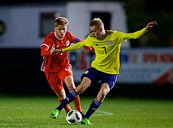 RHYL, WALES - Wednesday, November 14, 2018: Wales' captain Ryan Reynolds and Scotland's Zak Rudden during the UEFA Under-19 Championship 2019 Qualifying Group 4 match between Wales and Scotland at Belle Vue. (Pic by Paul Greenwood/Propaganda)