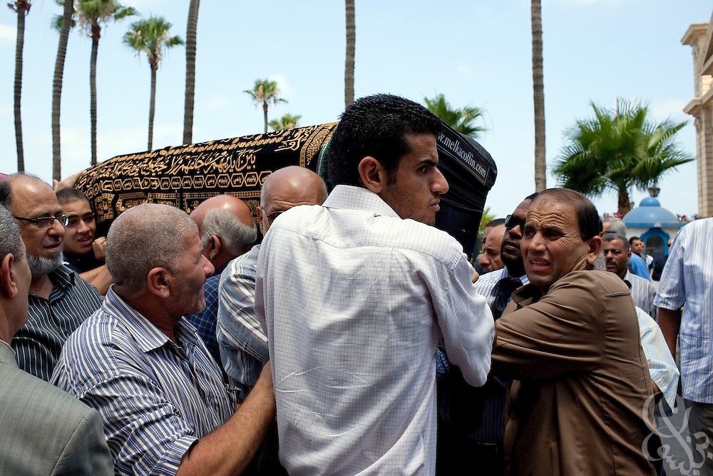 """Family members carry the coffin of Marwa Sherbini, 31, at her funeral in the Egyptian port city of Alexandria July 6, 2009. Sherbini was stabbed to death inside a German courtroom by a 28 year old attacker, Axel W., who had been previously convicted of insulting her religion. Newspapers in Egypt have expressed outrage over the attack and have dubbed her the """"martyr of the hijab"""" and """"headscarf martyr."""""""