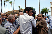 "Family members carry the coffin of Marwa Sherbini, 31, at her funeral in the Egyptian port city of Alexandria July 6, 2009. Sherbini was stabbed to death inside a German courtroom by a 28 year old attacker, Axel W., who had been previously convicted of insulting her religion. Newspapers in Egypt have expressed outrage over the attack and have dubbed her the ""martyr of the hijab"" and ""headscarf martyr."""