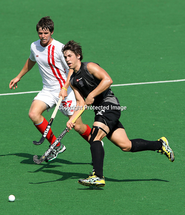 Nick Wilson of New Zealand and Adam Froese of Canada during the hockey match between New Zealand and Canada during the XiX Commonwealth Games  held at the MDC Stadium in New Delhi, India on the  10 October 2010<br /> <br /> Photo by:  Ron Gaunt/photosport.co.nz