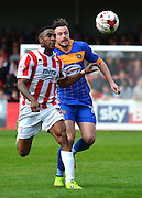 Craig Braham-Barrett and Andy Mangan chase the ball during the Sky Bet League 2 match between Cheltenham Town and Shrewsbury Town at Whaddon Road, Cheltenham, England on 25 April 2015. Photo by Alan Franklin.