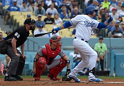 June 7, 2017 - Los Angeles, California, U.S. - Los Angeles Dodgers' Adrian Gonzalez singles as Washington Nationals catcher Jose Lobaton and home plate umpire Chad Whitson looks on in the first inning of a Major League baseball game at Dodger Stadium on Wednesday, June 7, 2017 in Los Angeles. (Photo by Keith Birmingham, Pasadena Star-News/SCNG) (Credit Image: © San Gabriel Valley Tribune via ZUMA Wire)