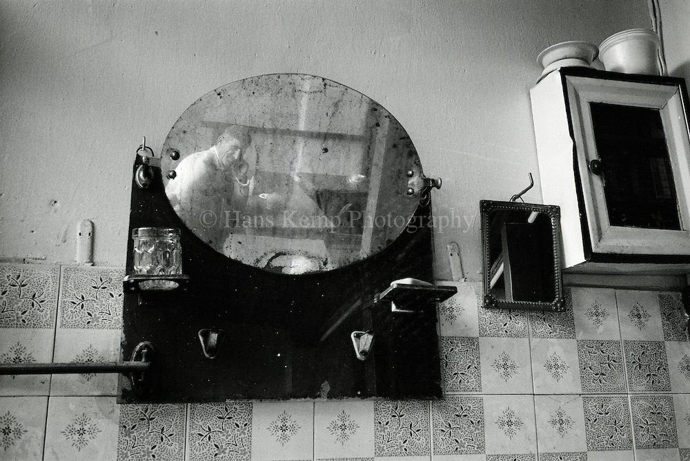 Reflection of a man in a mirror in  a teahouse in Masuleh, Northern Iran, 1997