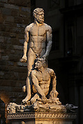 View from the front of statue of Hercules and Cacus, 1525-34, by Bandinelli, Piazza della Signoria, Florence, Tuscany, Italy, pictured on June 9, 2007, in the afternoon. The statue of Hercules and Cacus by Baccio Bandinelli (1525-34) was originally commissioned from Michelangelo as a pair to the David statue, and the re-assignment to Bandinelli was highly controversial; but the Medicis were satisfied and rewarded Bandinelli richly. The sculpture represents physical strength in contrast to David's spiritual strength. Florence, capital of Tuscany, is world famous for its Renaissance art and architecture. Its historical centre was declared a UNESCO World Heritage Site in 1982. Picture by Manuel Cohen.