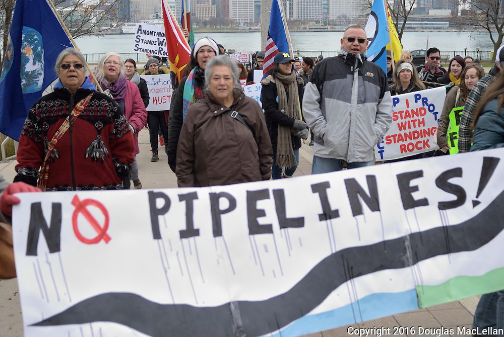 Standing Rock march and demonstration starts in Windsor, Canada with a smudging ceremony and speeches at Dieppe Park by the waterfront. A march to RBC branch on Ouellette and Chatham where more speeches are made. Finally a walk back to Dieppe Park for yet more speeches, information gathering for an email list and chili. Note after this demonstration on 4 May 2016 it is reported that the pipeline will not go through Sioux land. NOTE This image is exclusive to AGefotostock, G99-2779551 and may be licensed though this link: http://www.agefotostock.com/age/en/Stock-Images/Rights-Managed/G99-2779551