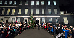 © Licensed to London News Pictures. 06/12/2017. London, UK. British Prime Minister Theresa May switches on the Downing Street Christmas tree lights whilst accompanied by a traditional children's choir singing carols. Photo credit : Tom Nicholson/LNP
