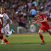 Joe Allen, (right), Liverpool, in action during the Liverpool Vs AS Roma friendly pre season football match at Fenway Park, Boston. USA. 23rd July 2014. Photo Tim Clayton