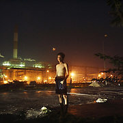 14-year old Anh stands by the side of the road outside the coal-powered electricty plant in Phai Lai, about 70 kilometers east of Hanoi, Vietnam, 14 September, 2007.