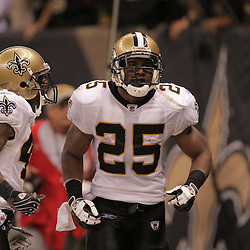 2008 October, 06: New Orleans Saints running back Reggie Bush (25) celebrates with teammate Jason David (42) after running back a punt 64-yards for a touchdown during the fourth quarter of a week five regular season game between the Minnesota Vikings and the New Orleans Saints for Monday Night Football at the Louisiana Superdome in New Orleans, LA.