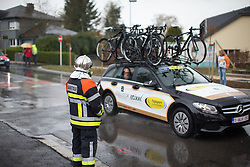 A firefighter watches the first, 106.9km road race stage of Elsy Jacobs - a stage race in Luxembourg, in Steinfort on April 30, 2016