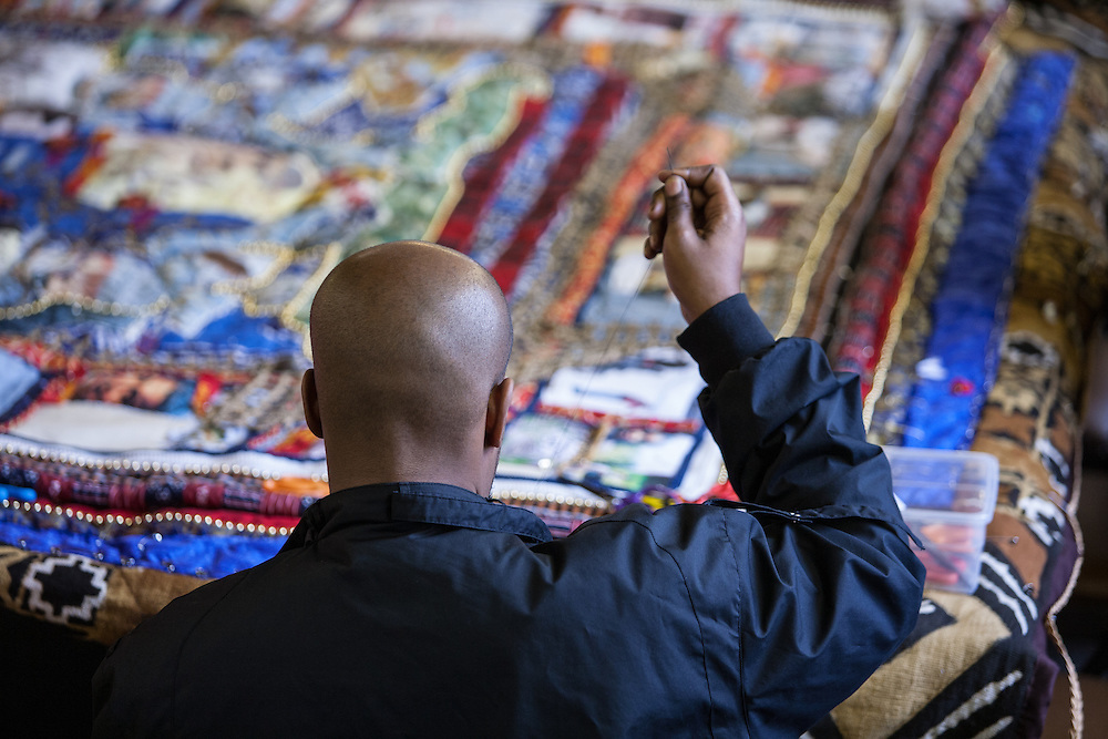 Shady Side, Maryland, US - 21 September 2009. A volunteer works on a quilt pieced from memorabilia of black watermen at the Salem Avery Museum in Shady Side, Maryland.