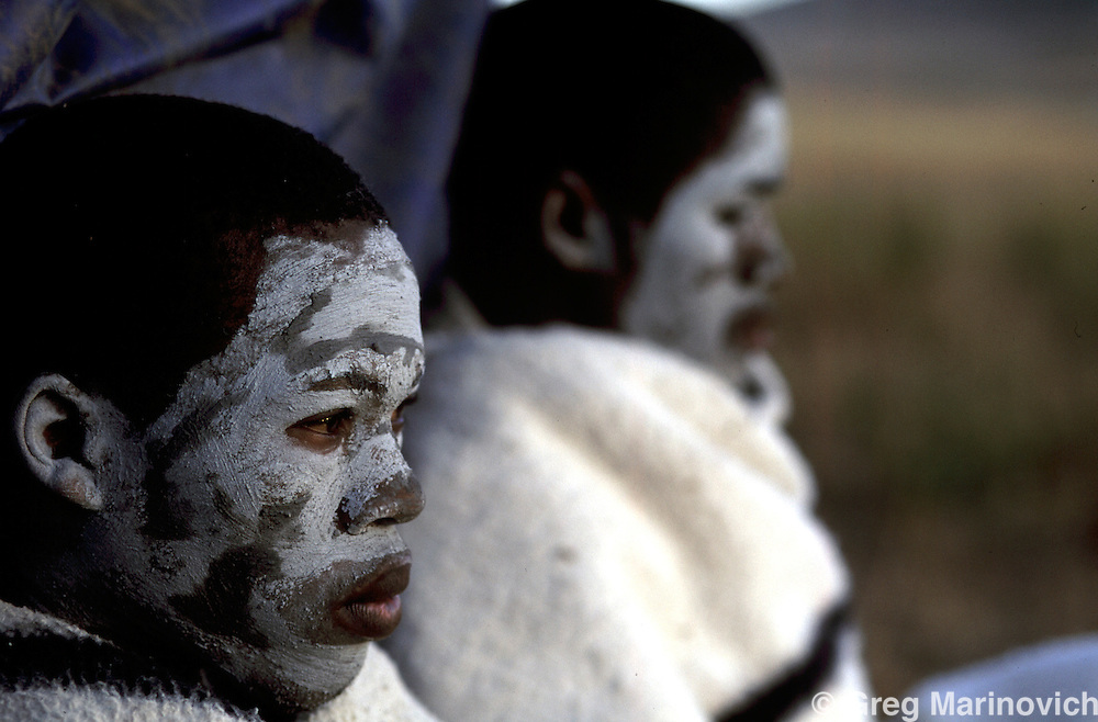 IPMG0383 South Africa, Umtata, 1995: Xhosa initiates with their white painted faces emphasizing their seclusion as they undergo the rite of passage to manhood in tribal Xhosa culture in the former Transkei homeland, near Umtata, July 1995. ..Photograph by Greg Marinovich/South Photographs