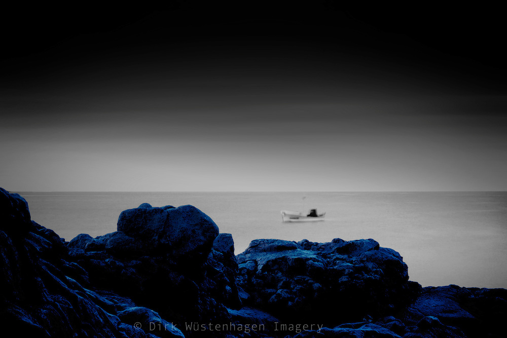 Long exposure of the sea near Puerto Naos/La Palma with a boat rocking in the surf.