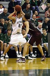 16 December 2006: Andrew Freeman guarded by Adam Machones. The University of Chicago Maroons upset  the Illinois Wesleyan Titans 64 - 60 at the Shirk Center in Bloomington Illinois.<br />