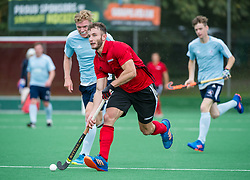 James Kyriakides comes away with the ball. Southgate v Old Georgians - Men's Hockey League, East Conference, Trent Park, London, UK on 23September 2017. Photo: Simon Parker