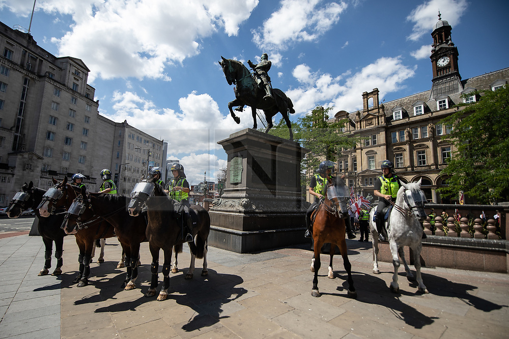 """© Licensed to London News Pictures . 07/07/2018 . Leeds , UK . Mounted police at an anti-Islam demonstration by supporters of jailed EDL founder Tommy Robinson , including those from the """" Yorkshire Patriots """" and """" First for Britain """" , in Leeds City Centre , opposed by anti-fascists . Robinson ( real name Stephen Yaxley-Lennon ) was convicted of Contempt of Court in May 2018 after committing a second offence , whilst serving a suspended sentence for the same crime . Photo credit : Joel Goodman/LNP"""