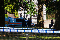 St James's Park, London, July 9th 2015. Horse Guards Parade and the Eastern end of St Jame's Park are evacuated as police cordon off the area to examine a suspect package left near the Guards Memorial. The package turned out to be harmless and was removed by Met Police officers who deployed sniffer dogs as part of their investigation.