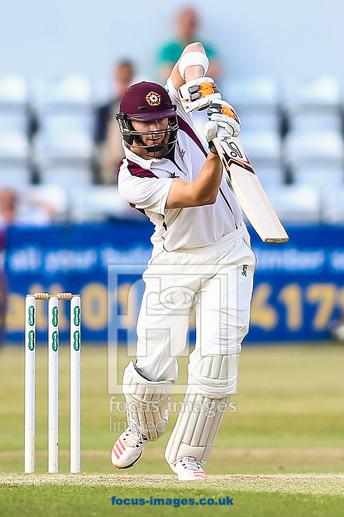 Rob Keogh of Northamptonshire CCC drives during the Specsavers County C'ship Div Two match at the County Ground, Northampton<br /> Picture by Andy Kearns/Focus Images Ltd 0781 864 4264<br /> 14/08/2016