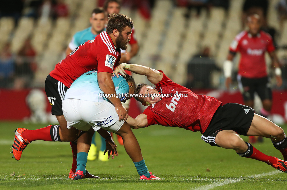 Colin Slade of the Crusaders tackles Clayton Blommetjies of the Cheetahs during the Investec Super Rugby game between the Crusaders v Cheetahs at AMI Stadium in Christchurch. 21 March 2015 Photo: Joseph Johnson/www.photosport.co.nz