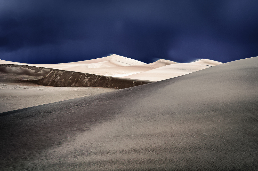Great Sand Dunes under stormy clouds.