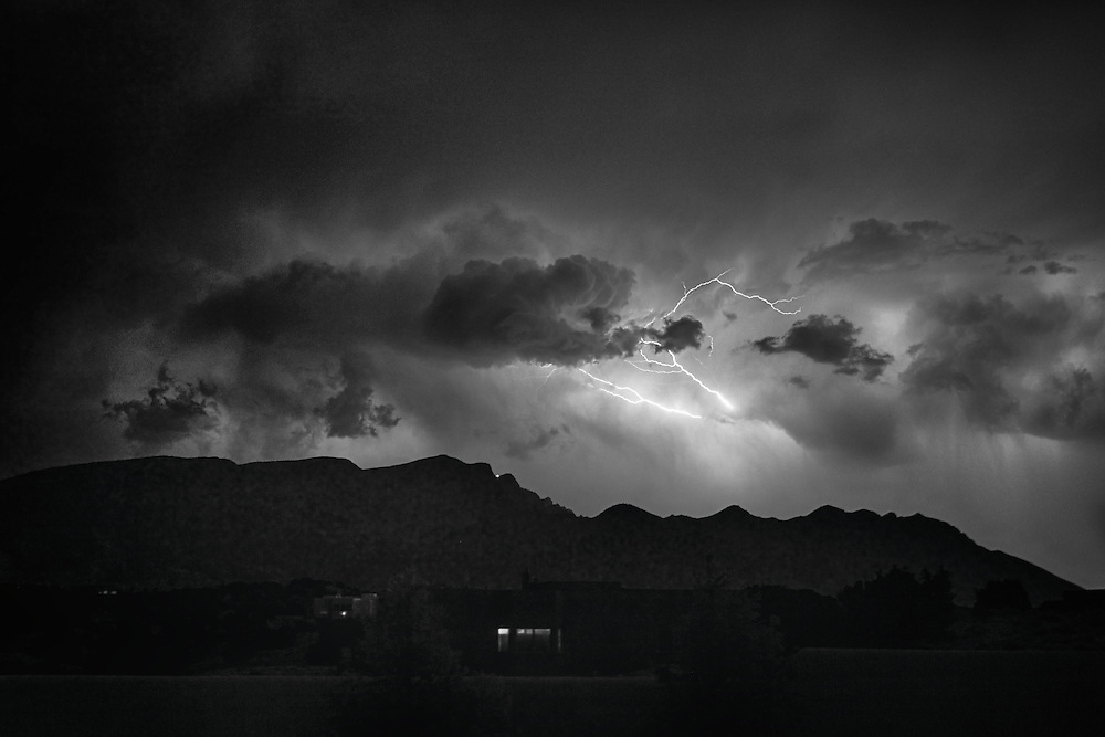 Monsoon season in the desert southwest brings intense lightning storms. Here lightning is seen over the Sandia Mountains in Placitas, NM.