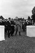 President John F. Kennedy attends a Garden Party at Aras an Uachtarain.  The Minister for External Affairs, Frank Aiken, wrestles aside an eager young autograph hunter, although a waiting Kennedy appeared willing..27.06.1963