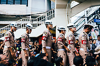 Officers make their way through the crowds to police the roadways for the funeral procession of King Bhumibol on June 14, 2016 in Bangkok, Thailand. Thailand's King Bhumibol Adulyadej, the world's longest-reigning monarch, died at the age of 88 in Bangkok's Siriraj Hospital on Thursday after his 70-year reign. Prime Minister Prayut Chan-ocha made a statement Thailand would hold a one-year mourning period as the Crown Prince Maha Vajiralongkorn confirmed that he would perform his duty as heir to the throne.