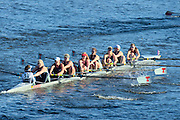 Cambridge. MA. USA.  1927 Boat Club, moving away from the Eliot Bridge,  The Championship eights. 49th edition of the Head of the Charles, Charles River.<br />