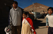 Potosi, Bolivia.<br /> The Benabides family home. When their father, a miner,  died 5 years ago of silicosis, five children live with their mother in this one room, two bed house. They sleep three to a bed. Lucas, 12, takes his siblings Gladys, 6, Beimar 8 and Bimer, 6, to their San Cristobal school.