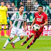 GRONINGEN - 23-10-2016, FC Groningen - AZ, Noordlease Stadion,  FC Groningen speler Tom Hiariej, AZ speler Dabney dos Santos Souza