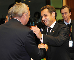 Nicolas Sarkozy, France's president, right, greets Alfred Gusenbauer, Austria's federal chancellor, during the European Summit, in Brussels, Belgium, Wednesday, Oct. 15, 2008.   (Photo © Jock Fistick)