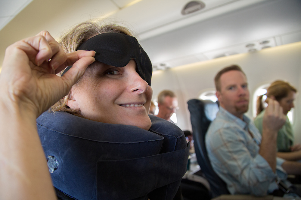 Cindy sports some travel comforts she stole from Matt who looks on with disgust.