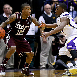 Jan 23, 2013; Baton Rouge, LA, USA; Texas A&M Aggies guard Fabyon Harris (12) is guarded by LSU Tigers guard Anthony Hickey (12) during the second half of a game at the Pete Maravich Assembly Center. LSU defeated Texas A&M 58-54. Mandatory Credit: Derick E. Hingle-USA TODAY Sports