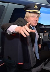 Boris Johnson Opening of The Emirates Aviation Experience.<br /> London Mayor Boris Johnson during the official opening of The Emirates Aviation Experience. The mayor and Emirates president Tim Clark will also hold a Q&amp;A at the attraction, which includes a full-size replica nose-cone of a double-decker A380 complete with flight-deck as well as an A380 flight simulator. <br /> Greenwich Peninsula Terminal, London, United Kingdom Friday, 5th July 2013 Picture by Andrew Parsons / i-Images<br /> <br /> File Photo - New runways at Heathrow and Gatwick are among the options that have been short-listed by the Airports Commission for expanding UK airport capacity.<br /> Date filed Tuesday 17th December 2013. Photo By Andrew Parsons/ i-Images.