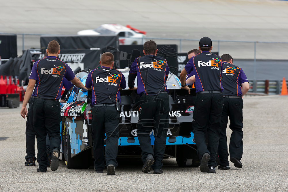 DOVER, DE - JUN 01, 2012:  The FedEx crew prepare their Toyota Camry for a practice session for the FedEx 400 Benefiting Autism Speaks at the Dover International Speedway in Dover, DE.