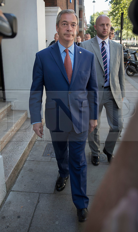 © Licensed to London News Pictures. 04/07/2016. London, UK. Nigel Farage leaves the Emanuel Centre after announcing his intention to stand down as UKIP party leader. Photo credit: Peter Macdiarmid/LNP