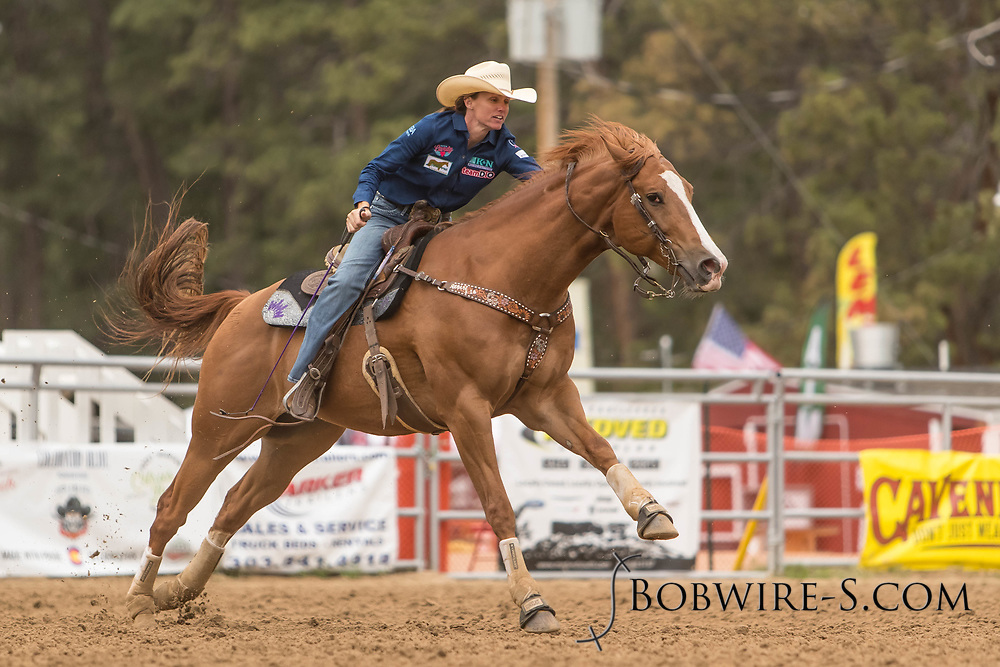 Ericka Nelson makes her barrel racing run during slack at the Elizabeth Stampede on Sunday, June 3, 2018.