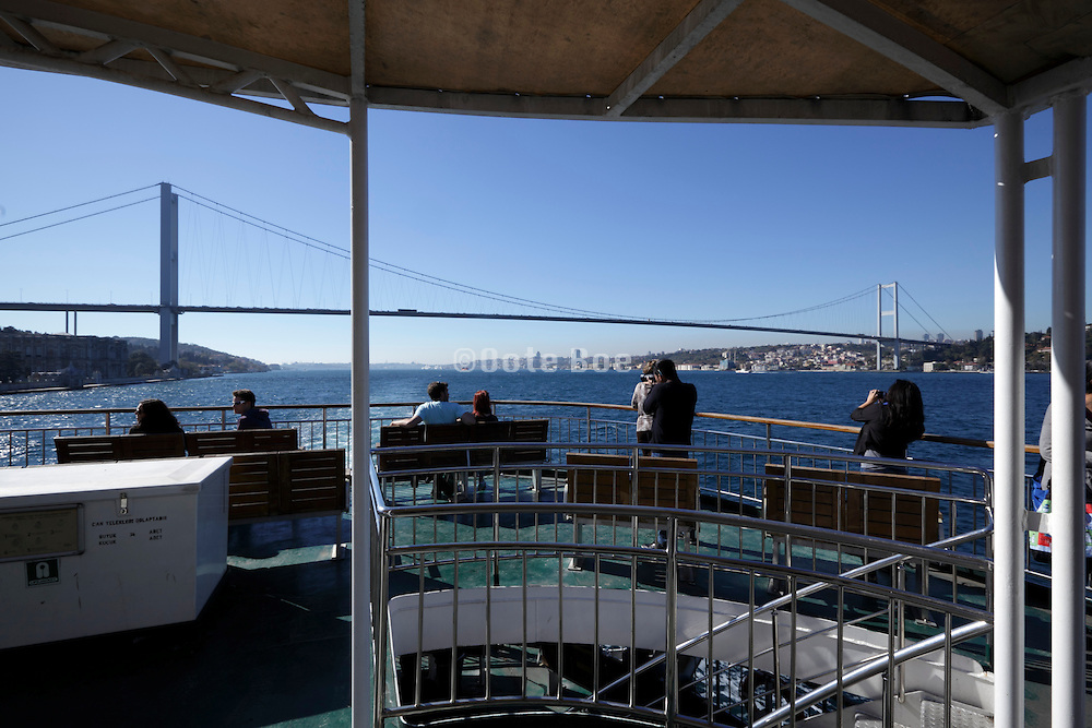 The first Bosphorus bridge spanning the Strait of Istanbul seen from a tourist cruise boat Turkey