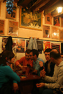 """Tasca do Chico"" is one of the typical spots were to see live perfomances of Fado music and were the audience can spontaneously participate and also ask to sing. It is located in  Bairro Alto neighborhood"