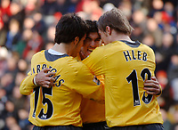 Photo: Glyn Thomas.<br />Charlton Athletic v Arsenal. The Barclays Premiership.<br />26/12/2005.<br /> Arsenal's Jose Antonio Reyes (C) celebrates with Alexander Hleb (R) and Francesc Fabregas (L) after scoring a goal.