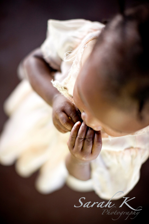 Saraphina nibbles at her fingers in an orphanage near Port-au-Prince, Haiti. There is often not enough food to feed all the children in the orphanage.